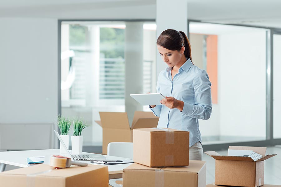 Woman working in office in Andover UK